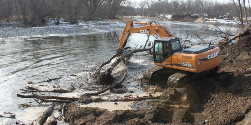 excavator in the river dredging