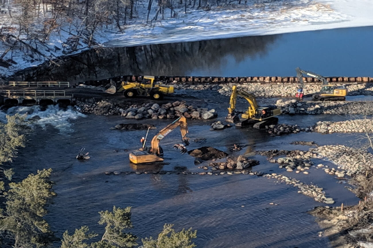 construction crews in the river dredging